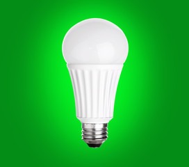 LED Light Bulb on green background