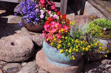 Vintage composition decorative flowers in a old vase