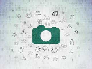 Tourism concept: Photo Camera on Digital Paper background