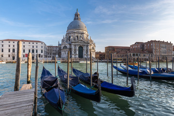Gondolas in Grand Canal and Basilica Santa Maria della Salute in