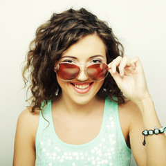 happy teen girl with sunglasses