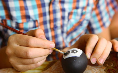 boy  decorate easter egg and cake