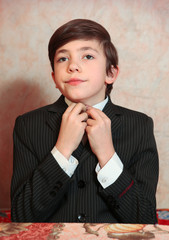 boy in businessman suit and tie
