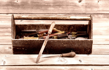 Vintage wooden toolbox filled with work Tools