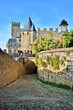 Fortress of Carcassonne behind arched cobblestone lane, France