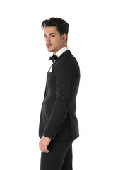 Handsome elegant young man with suit and bow-tie, isolated