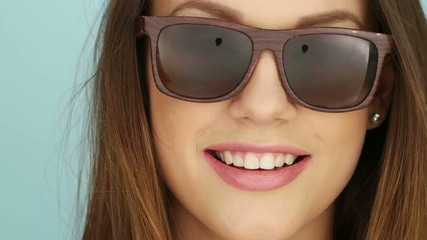 Attractive Young Woman Posing In Brown Sunglasses