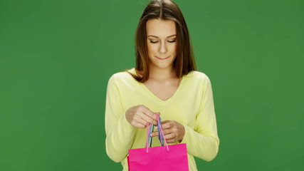 Attractive Young Woman Holding Colourful Shopping Bags