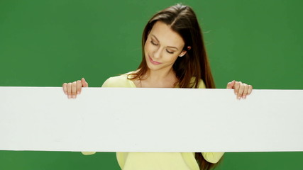 Attractive Young Woman Holding A White Banner