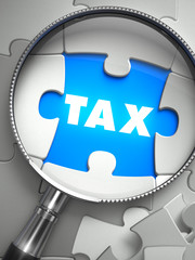 Tax - Missing Puzzle Piece through Magnifier.