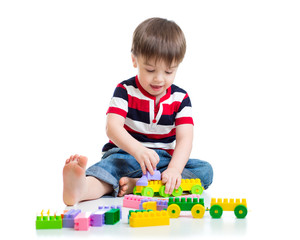 Portrait of little boy with toy blocks
