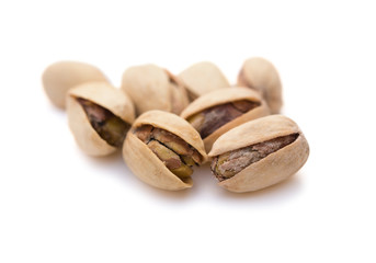 close up pistachio nuts on white with clipping path