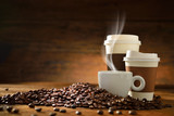 Fototapety Cups of coffee and coffee beans on old wooden background
