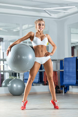 Sportive woman with ball in the gym