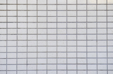 White tiled wall background