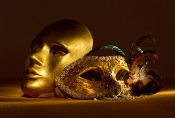 Two golden Venetian masks