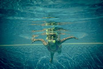 Underwater portrait of happy child