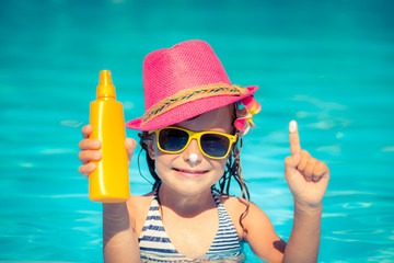 Child holding sunscreen lotion