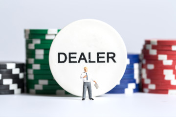 Businessman in front of a dealer sign and chips