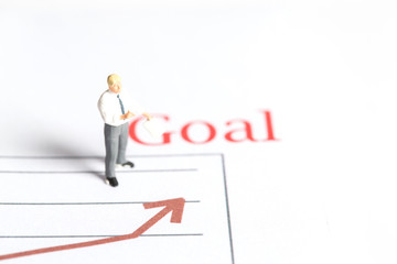 Businessman is standing near a goal.