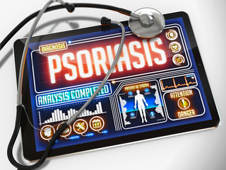 Psoriasis on the Display of Medical Tablet.