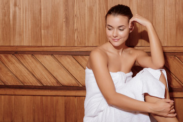 Woman relaxes in a sauna