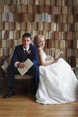 The bride and groom on the wicker furniture