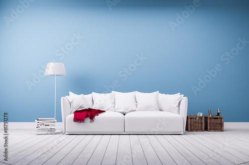 Leinwanddruck Bild Couch und Stehlampe vor blauer Betonwand