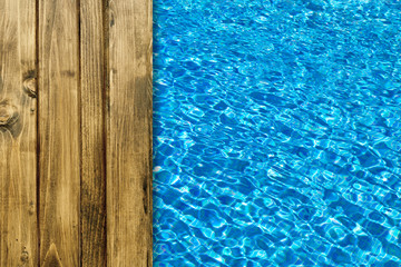 Pool water surface and wooden deck for backgrounds