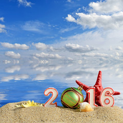 New year 2016 sign on a beach sand with seashells
