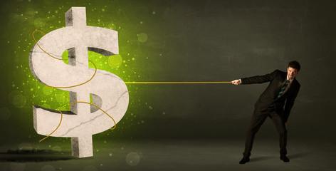 Business man pulling a big green dollar sign