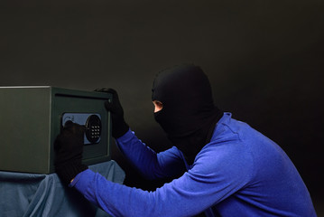 The thief breaks the safe with a combination lock