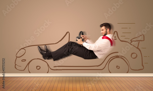 Happy man driving an hand drawn car on the wall - 81755252