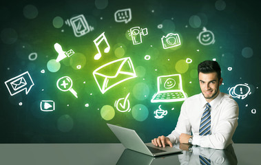 Businessman with social media symbols