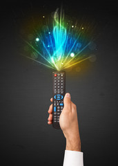 Hand with remote control and explosive signal