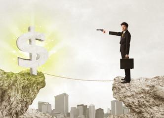 Businessman on rock mountain with a dollar mark