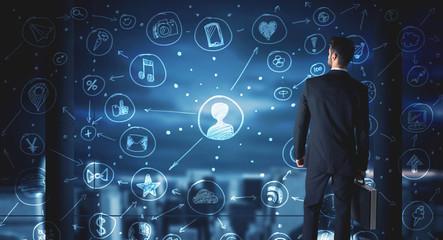 Businessman drawing social media connection scheme