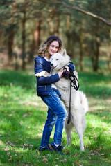 Happy girl with husky dog