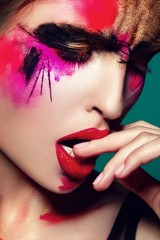 Beautifulgirl with creative colorful makeup closeup
