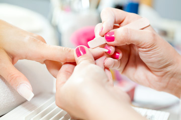 Nail treatment in beauty salon