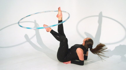 Spinning acrobat beautiful hula hoops in slow motion