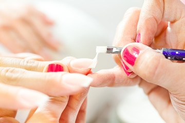 Process of nail treatment, applying white paint on fingernail