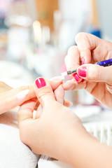 Process of nail treatment, applying white paint on fingernail