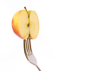Concept of vegetarian food. Apple on fork