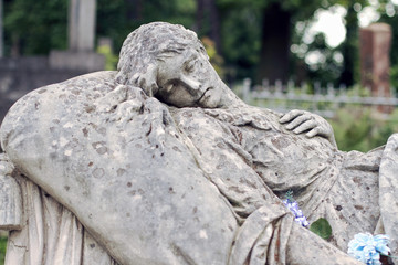 Old statue on grave in the Lychakivskyj cemetery of Lviv, Ukrain