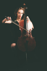 Woman Playing a Cello Instrument Looking at Camera