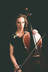 Pretty Young Woman Holding a Cello Instrument
