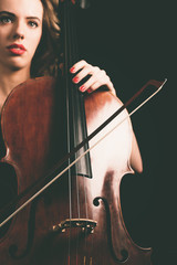 Cello Instrument and Bow Held by a Pretty Lady