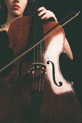 Cello and Bow Instrument Hold by a Female Musician