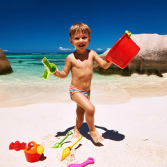 Two year old boy playing on beach
